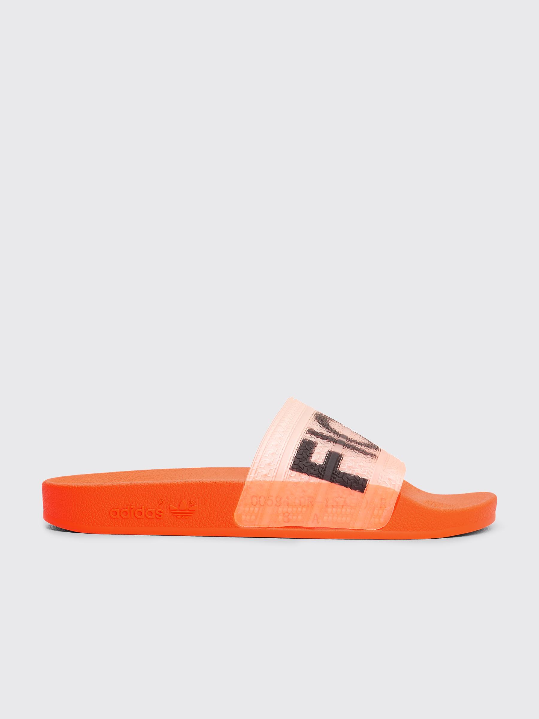 08078738b99 Très Bien - adidas x Fiorucci Adilette Solar Orange